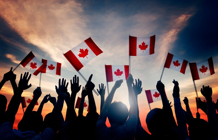 Group of people with Canadian flags