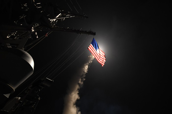 The guided-missile destroyer USS Porter fires a Tomahawk missile in strike operations on April 7, 2017. IMAGE SOURCE: U.S. Navy