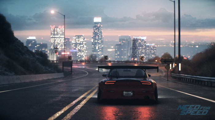 Screenshot of sports car driving down road in Need for Speed video game.