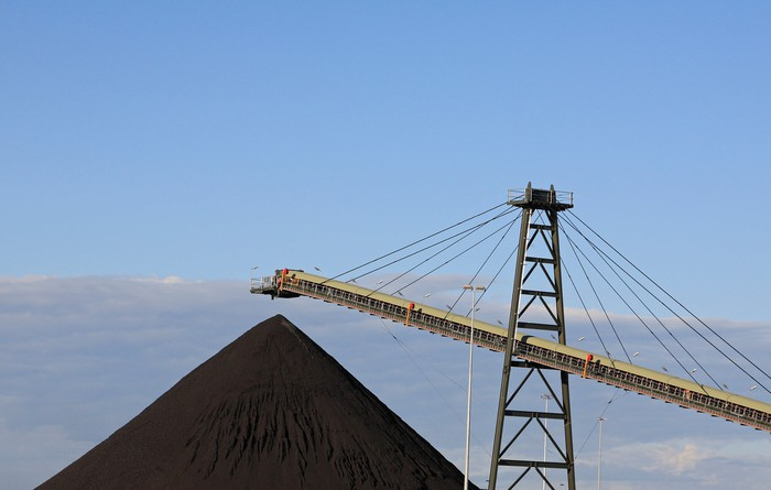 Australia met coal production being piled up and waiting for loading onto a barge.