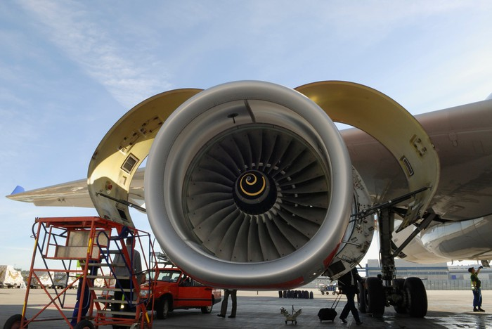 A jet engine being opened for routine maintenance.