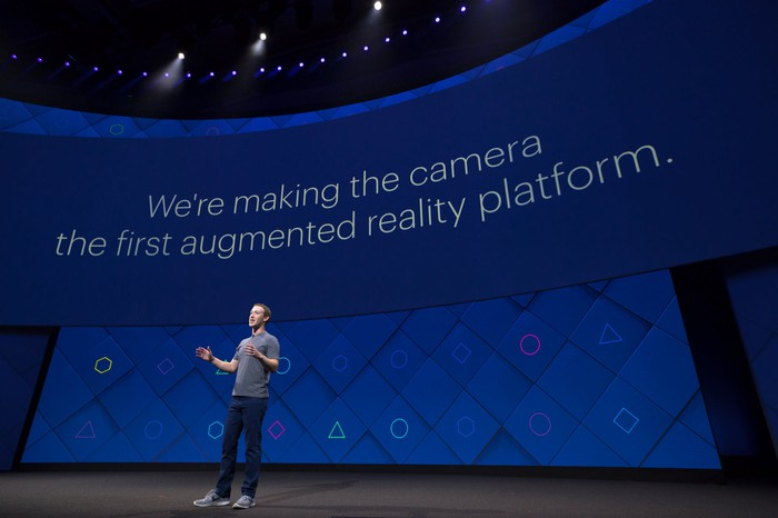 Zuckerberg on stage presenting Facebook's new augmented reality platform