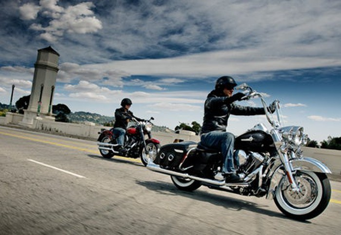 Two Harley-Davidson motorcycles on the open road