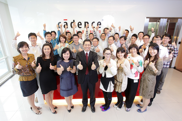A group of Cadence employees in Taiwan give a thumbs up.