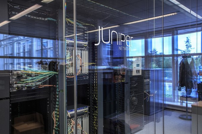 The outside of a glass office door that says Juniper on it.
