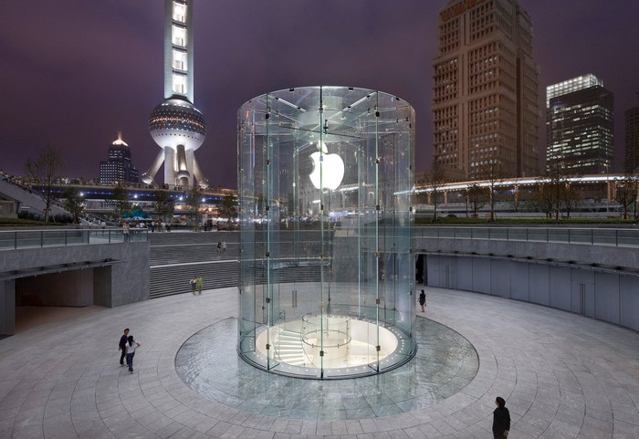 Apple's round, all-glass entrance to its Shanghai China store stands sharp relief in front of Shanghai's distinctive skyline