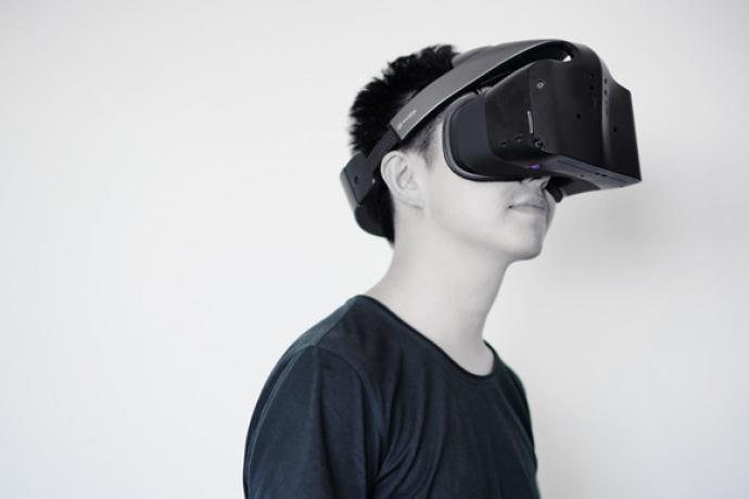 A man wearing an Intel VR headset.