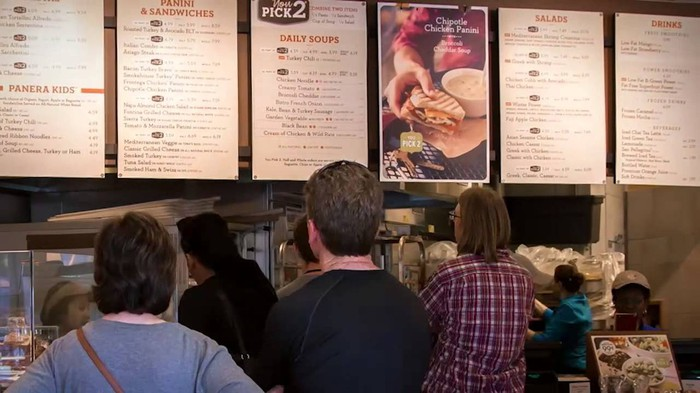 An interior shot of a Panera counter with the full menu.