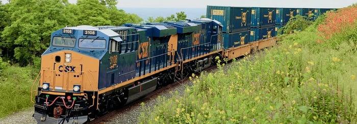 A CSX train in motion through the countryside