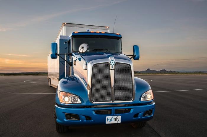 A blue tractor-trailer truck.