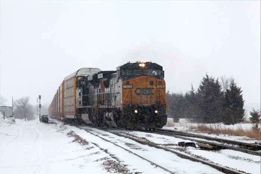 A CSX train moving down the track.