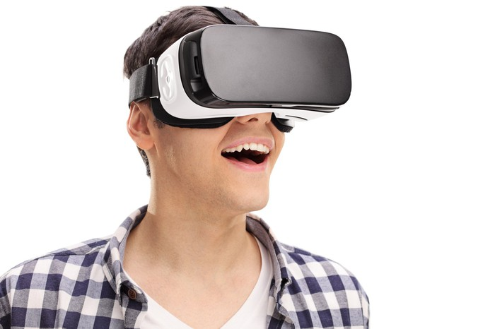 Man wearing VR goggles seems amazed.