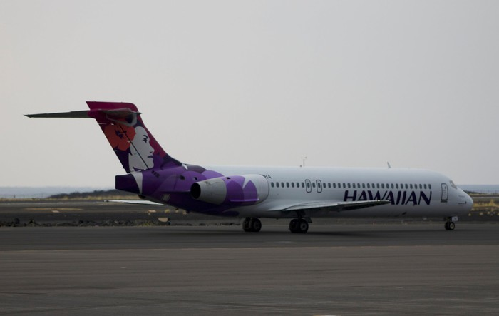 A Hawaiian Airlines plane on a runway