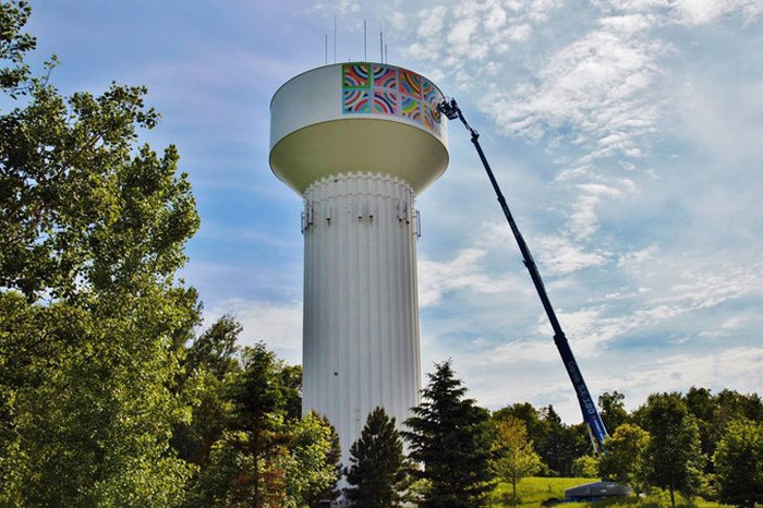 A banner printed with EFI technology is installed on a water tower.