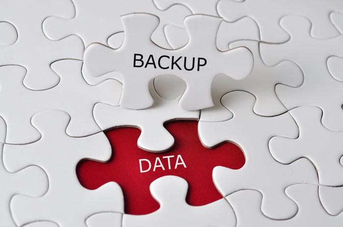 """Jigsaw puzzle pieces featuring the words """"backup"""" and """"data."""""""