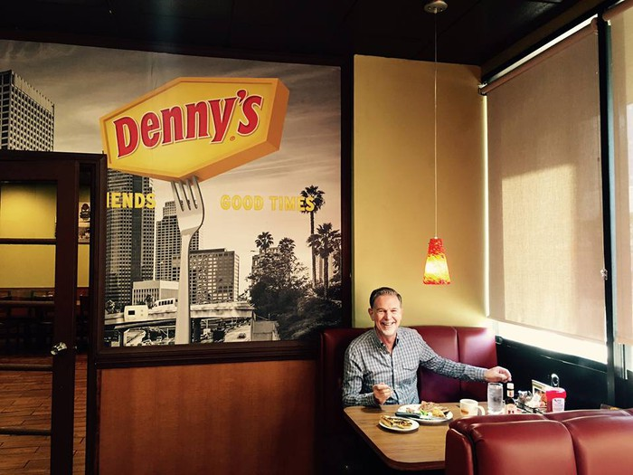 A photo uploaded by Netflix's CEO to Facebook, enjoying a steak dinner at Denny's.