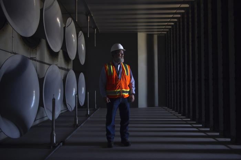 A man in a GE gas-turbine testing facility