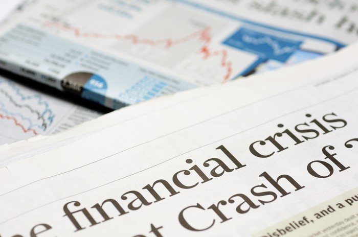"Newspaper headline that reads ""financial crisis""."