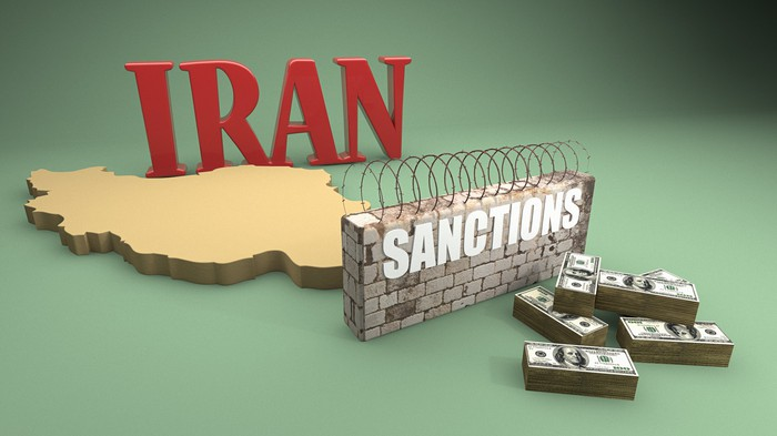 """The map outline of the country of Iran and the word """"Sanctions""""."""