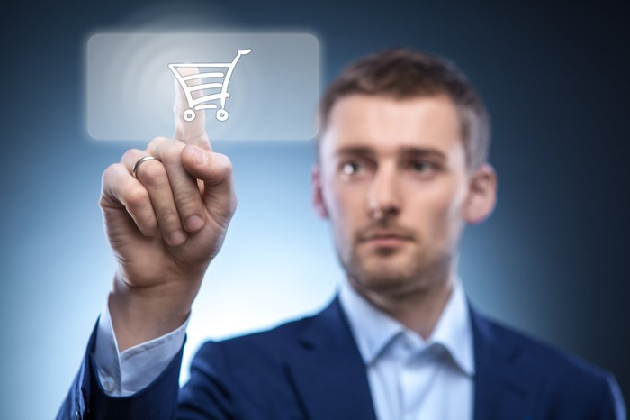Man touching shopping cart button