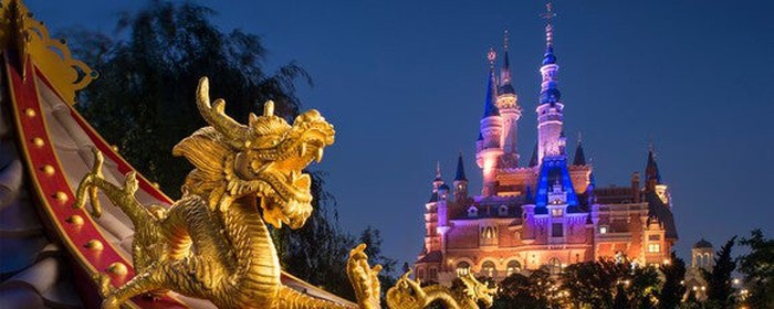 Nighttime view of a castle at Shanghai Disney park.