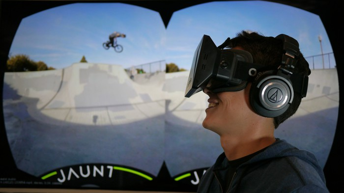 Young man with headset viewing a VR scene.