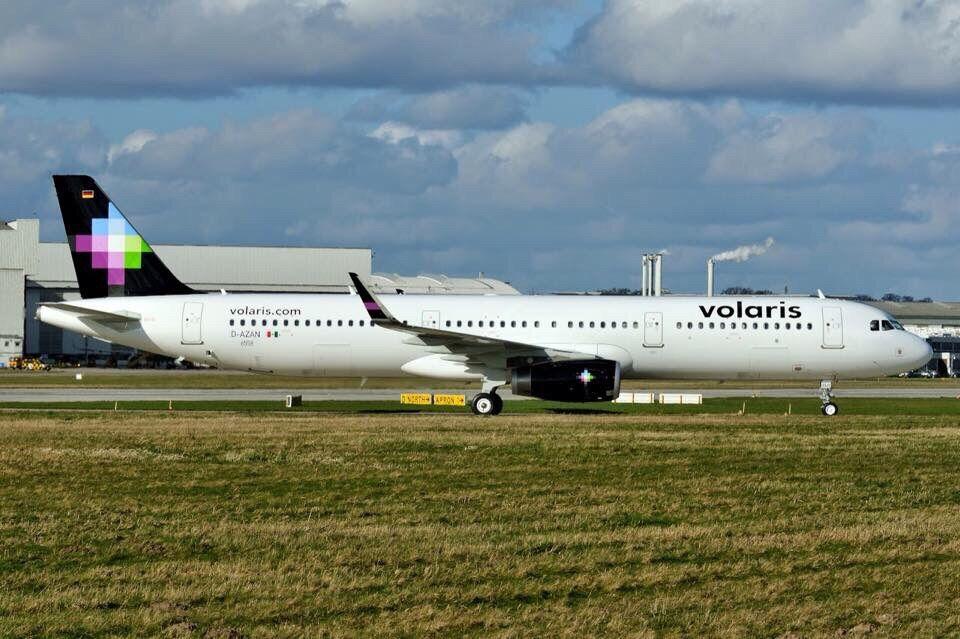 A Volaris plane on the ground.