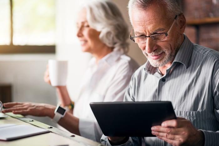 Older couple using electronics.