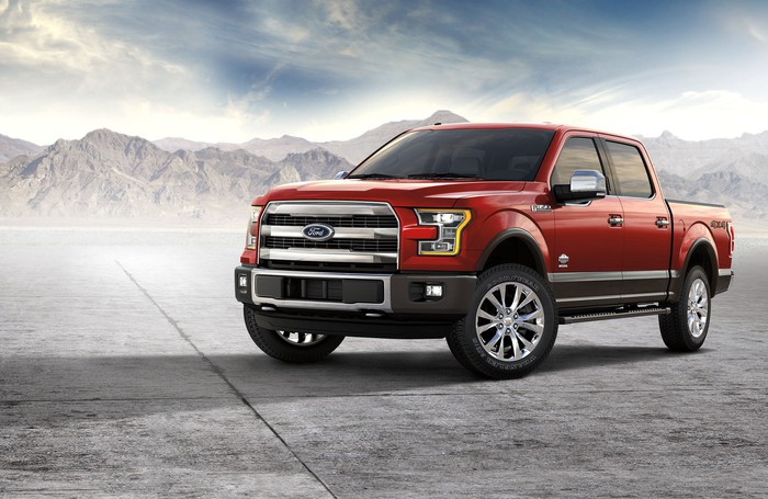 A red Ford F-150 King Ranch pickup.