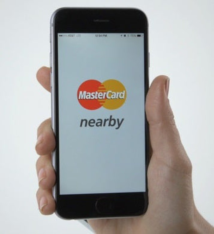 A smartphone user making mobile payment with MasteCcard.