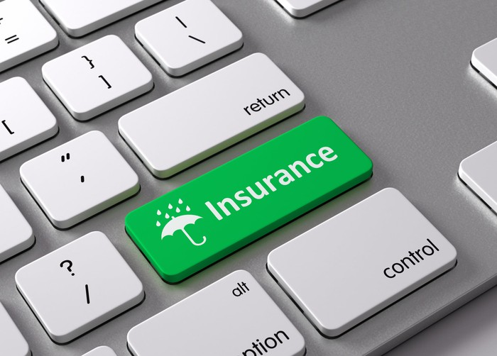 """Green button on keyboard that's labeled """"insurance"""" with an umbrella icon"""