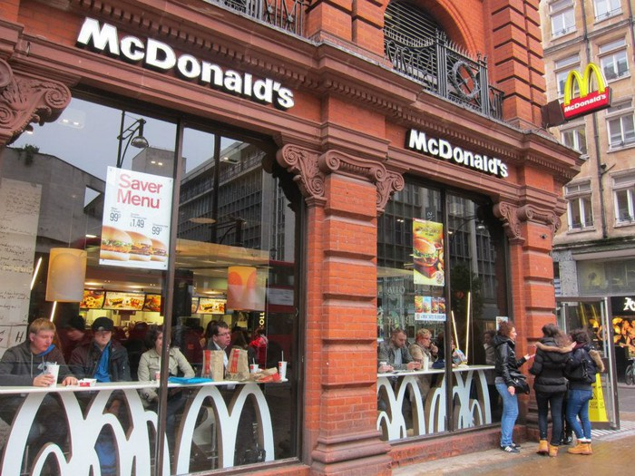 A McDonald's restaurant on a street corner