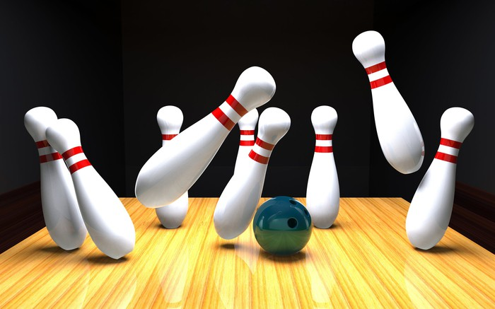 Bowling pins knocking each other over.