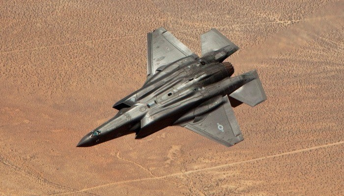F-35 fighter flying upside down.