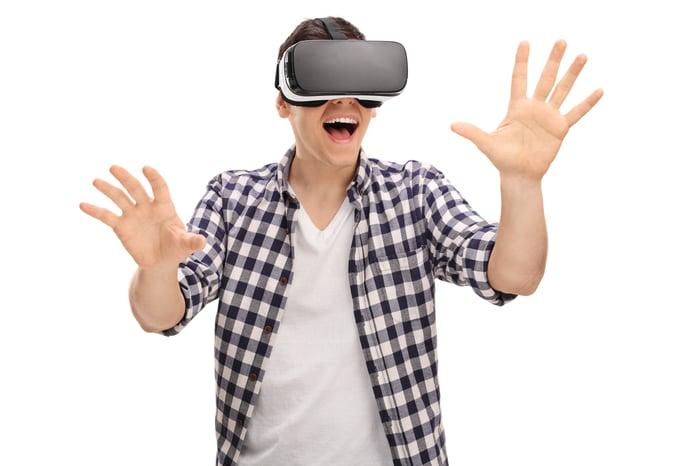 Man wearing virtual reality headset.