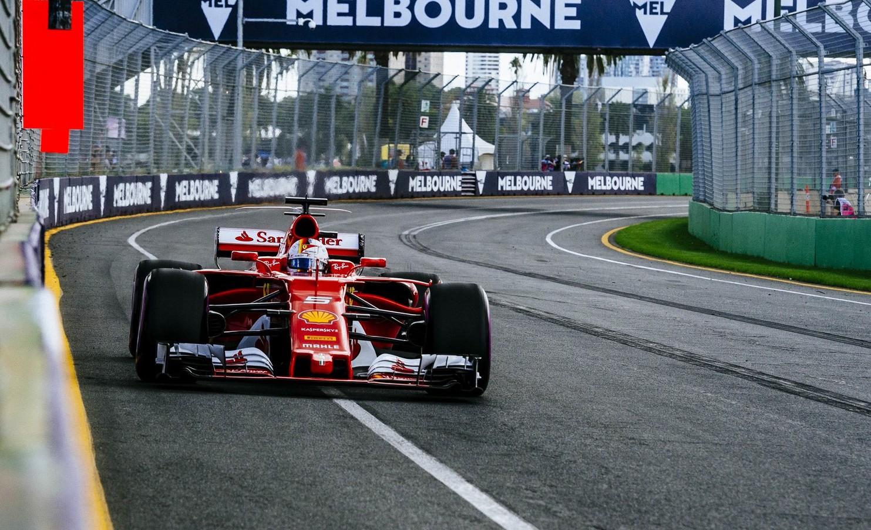 A red Ferrari Formula One race car on a racing track.
