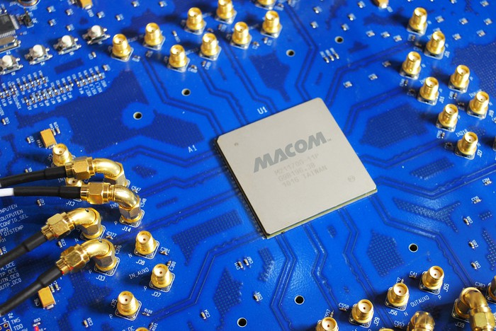 A semiconductor chip with the MACOM label on it.