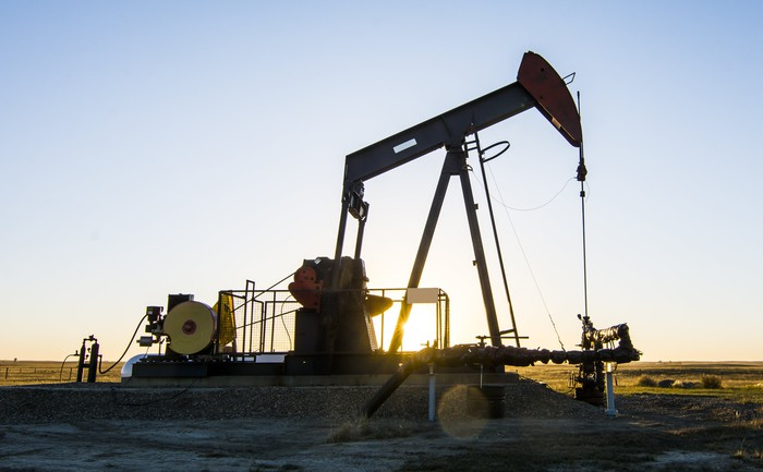 A pump jack at an oil well in Southern Alberta.