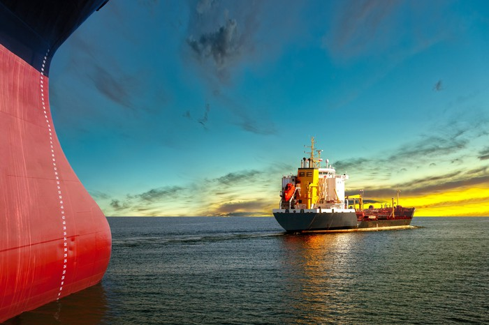 Tanker ships at sunset.