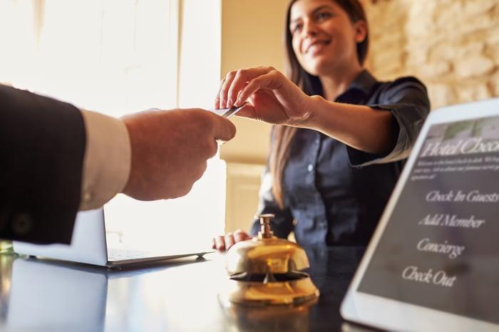 Hotel guest gets a hotel keycard.