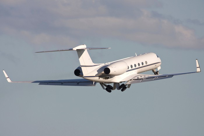 A Gulfstream business jet in the air.
