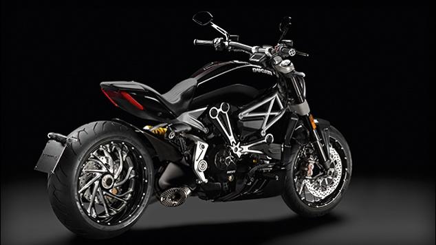A sleek Ducati sports bike in black against a black background