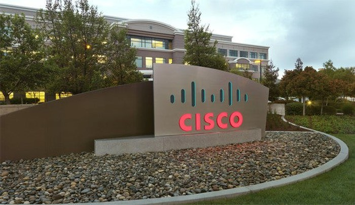 Cisco sign in front of Cisco building.