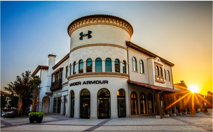 """Sun rising over Under Armour """"Brand House"""" retail store."""