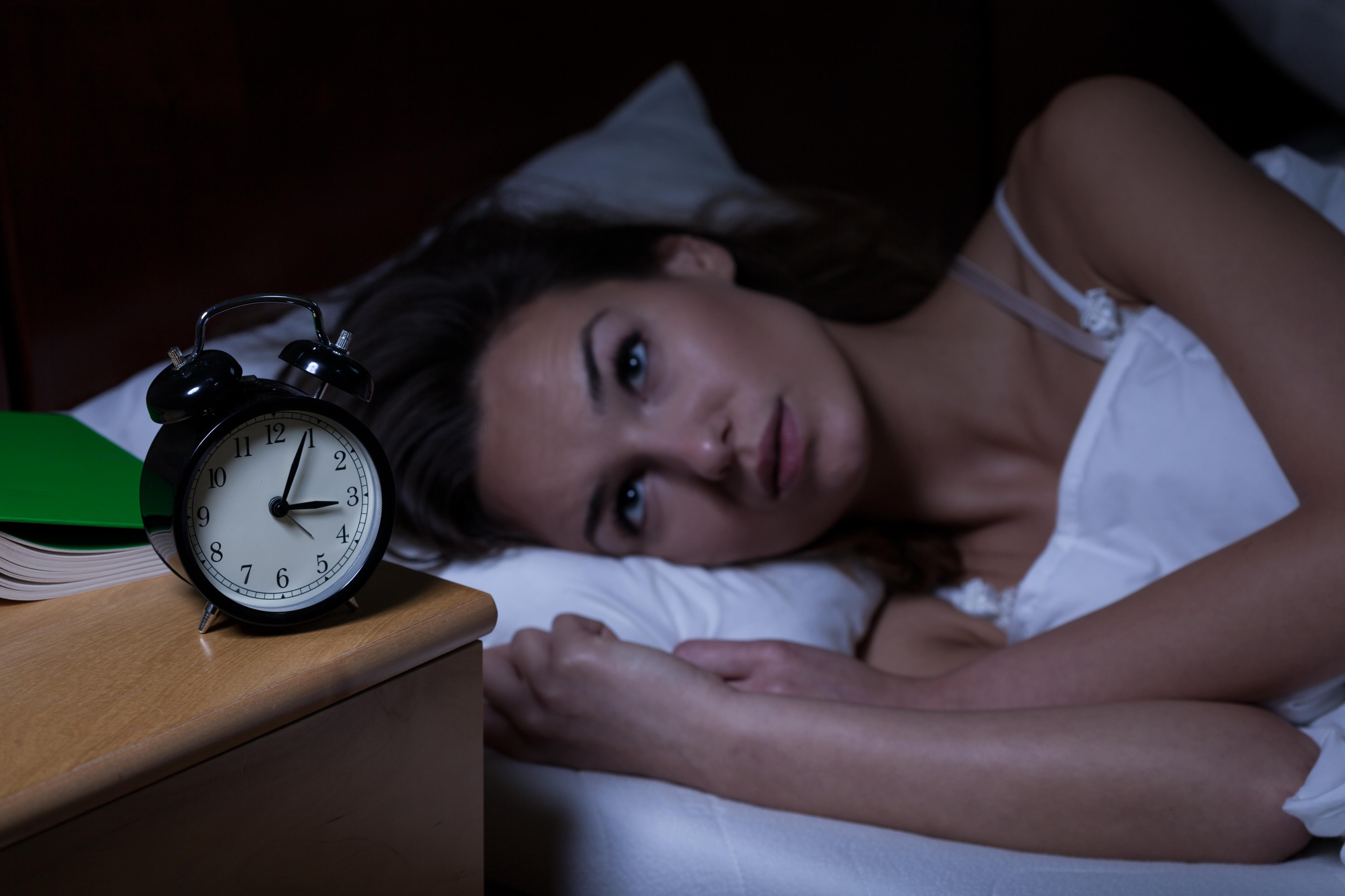 Woman in bed awake at night