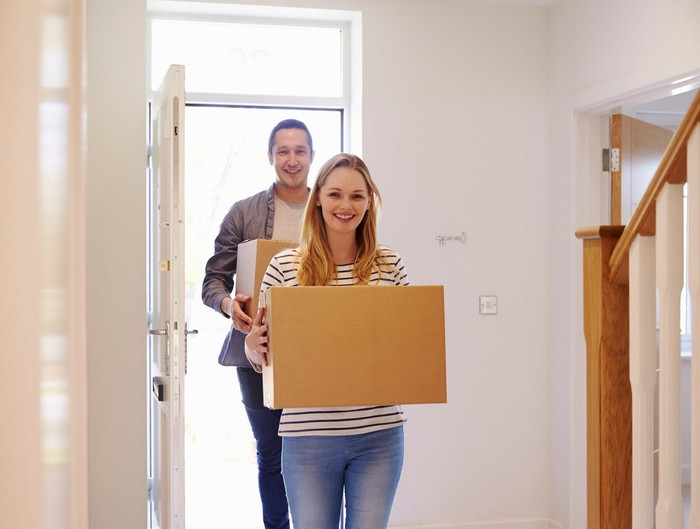 Young couple moving into a new home.