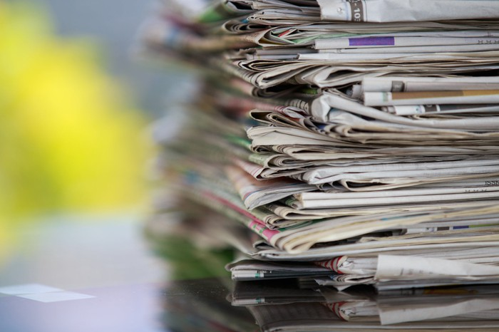 Stack of newspapers and magazines.