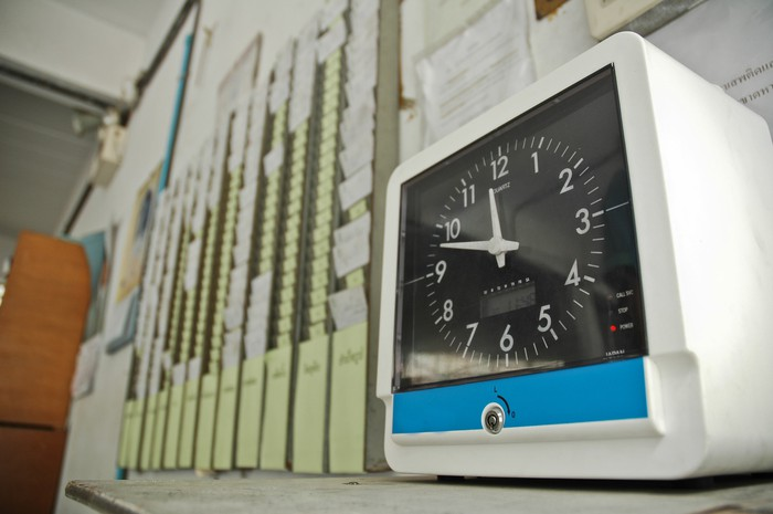 A time clock where workers punch in.