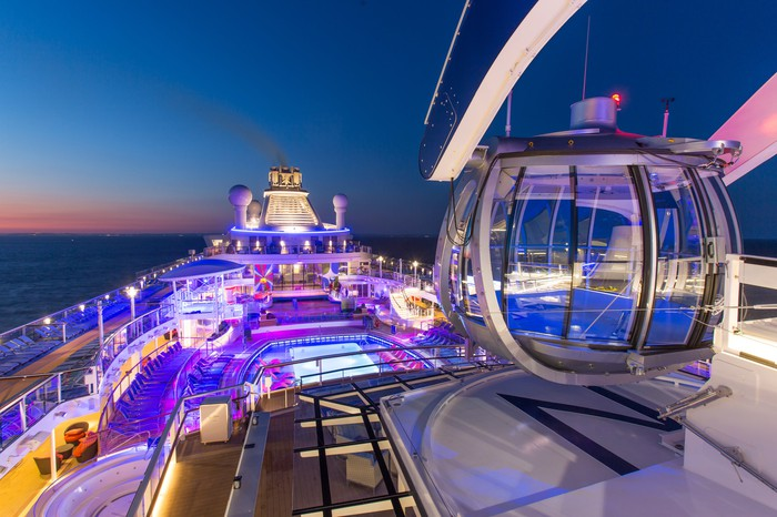A observatory deck on top of a Royal Caribbean cruise ship lit up at night.