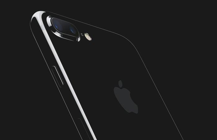 A jet black version of Apple's iPhone 7 Plus is set against a black background